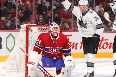 Sharks' Jonathan Dahlen celebrates his teammate's second-period goal as Canadiens goalie watches helplessly Tuesday night at the Bell Centre.