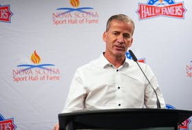 Curler Mark Dacey talks at a Nova Scotia Sports Hall of Fame event at the Scotiabank Centre on Wednesday, Oct. 20, 2021. Dacey's 2004 Brier-winning team will be inducted into the Hall of Fame during a ceremony in November.