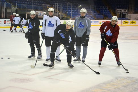 Charlottetown Islanders forward Sam Bowness works on his shooting with some teammates at the end of practice at Eastlink Centre on Oct. 19. The Quebec Major Junior Hockey League team recalled Bowness, who's from Clyde River, earlier this week from the Mount Academy under-18 team.