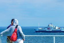 Passengers on one Northumberland Ferries vessel look across the water at a passing NFL ship travelling between Prince Edward Island and Nova Scotia. Vice president and general manager Don Cormier said all employees and travellers will need to be fully vaccinated.