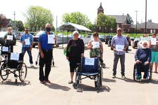 Each year, Marcia Carroll, centre, and the PEI Council of People With Disabilities does a demonstration highlighting the misuse of designated parking spots. People with invisible disabilities are often challenged on their eligibility to use the parking spots.
