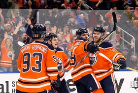 The Edmonton Oilers' Leon Draisaitl (A) (29) and Connor McDavid (C) (97) celebrate Draisaitl's first period goal against the Anaheim Ducks during NHL action at Rogers Place, in Edmonton Tuesday Oct. 19, 2021.