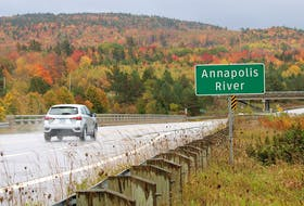 A motorist prepares to drive over the Annapolis River on Highway 101 near Bridgetown on Oct. 17.
