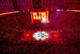 In this June 2, 2019, file photo, the court is illuminated at Toronto's Scotiabank Arena ahead of the first half of Game 2 of the NBA Finals between the Toronto Raptors and the Golden State Warriors. The Raptors played in Tampa in the 2020 season due to the pandemic.