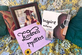 Displayed next to her YCMHS Class of 2021 graduation photo are paintings that were made by Yarmouth County teenager Hali Graves, as well as a photo of her with her parents when she was just a baby. At the age of 19, Graves died in a single-vehicle collision on Sept. 24. TINA COMEAU • TRICOUNTY VANGUARD