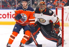 Edmonton Oilers forward Kailer Yamamoto (56) and Anaheim Ducks goaltender Anthony Stolarz (41) follow the play during the first period at Rogers Place.