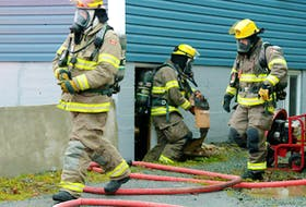 Firefighters made quick work of fire in a basement at a Mount Pearl business Thursday morning.