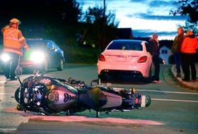 One man was sent to hospital following a collision between a car and a motorcycle in St. John's Thursday night.