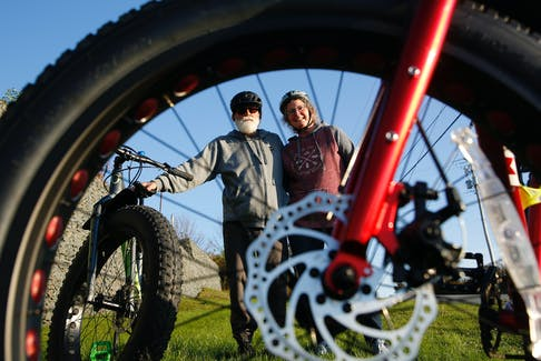 FOR MUNRO STORY: Wayne and Allana Loh are seen with their fat wheel bikes, in Dartmouth Thursday October 21, 2021. The couple was asked to leave a ferry with their bikes, as there is no room to accommodate fat wheeled bikes on the new bikes racks on the ferries....SEE MUNRO STORY FOR MORE DETAILS  TIM KROCHAK PHOTO
