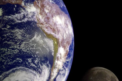 During its 1998 flight, NASA's Galileo spacecraft returned images of the Earth and moon. Separate images were combined to generate this view. - NASA