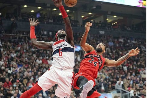 Washington Wizards center Montrezl Harrell (6) and Toronto Raptors center Khem Birch (24) fight for a rebound during the first half at Scotiabank Arena.