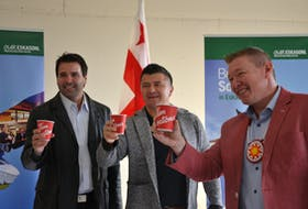Tim Hortons franchisee Troy Wilson, left, Eskasoni Chief Leroy Denny, centre, and Sydney-Victoria MP Jaime Battiste celebrate the announcement of a new Tim Hortons location in the Mi'kmaw community, expected to open in December. ARDELLE REYNOLDS/CAPE BRETON POST