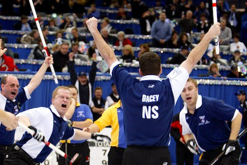 Nova Scotia skip Mark Dacey and his rink celebrate their win over Alberta in the Brier final in Saskatoon, Sask., March 14, 2004. Left to right: Third Bruce Lohnes, second Rob Harris, Dacey and lead Andrew Gibson. - Shaun Best / Reuters