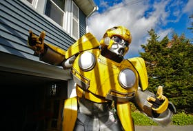 FOR COOKE STORY: Alden Burke poses in his Bumblebee costume in front of his Halifax home Wednesday October 20, 2021. FOR HAL CON tee up.  TIM KROCHAK PHOTO