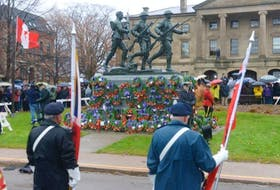 The Royal Canadian Legion colour party stands in front of the cenotaph in Charlottetown during a Remembrance Day ceremony.