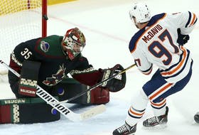 Edmonton Oilers center Connor McDavid (97) scores a short-handed goal against Arizona Coyotes goaltender Darcy Kuemper (35) during the first period of an NHL hockey game Saturday, March 16, 2019, in Glendale, Ariz.