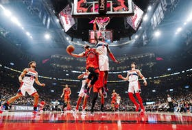 Fred VanVleet #23 of the Toronto Raptors goes to the basket against Montrezl Harrell #6 of the Washington Wizards during the second half of their basketball game at Scotiabank Arena.