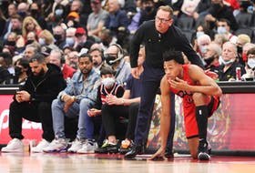 Scottie Barnes #4 of the Toronto Raptors talks with head coach Nick Nurse before going into the game against the Washington Wizards on Wednesday night.