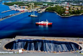 A stockpile of road salt is covered near the Richmond Terminal in Halifax on Sept. 22.  TIM KROCHAK