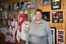 In her Stellarton home, Cathy Mason stands in front of a wall of souvenirs and special memories from the many events she has attended as a Special Olympics volunteer.