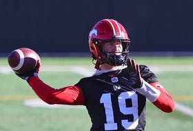 Calgary Stampeders quarterback Bo Levi Mitchell throws a pass during practice at McMahon Stadium on Thursday.