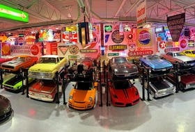 An amazing collection of historic signs form the backdrop for classic cars displayed in the neon mancave built by friends Jeff Budnick and Danny Amoroso. Contributed/Jeff Budnick