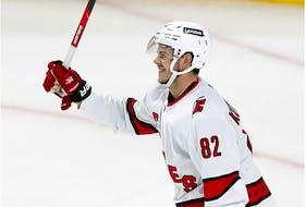 Carolina Hurricanes' Jesperi Kotkaniemi celebrates his third-period goal against the Montreal Canadiens in Montreal on Oct. 21, 2021.