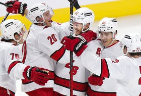 The Carolina Hurricanes' Jesperi Kotkaniemi (centre) is congratulated by teammates after scoring goal in 4-1 win over the Canadiens Thursday night at the Bell Centre.