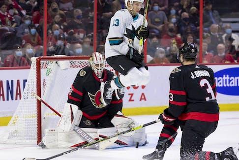 Sharks centre Nick Bonino jumps as he screens Senators goaltender Matt Murray during the second period of Thursday's game.