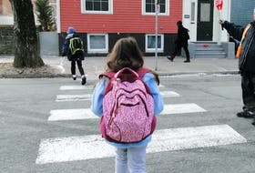 A photo of a girl crossing the street was taken by one of the newcomer families participating in a research project led by Dr. Jessie-Lee McIsaac, assistant professor and director of the Early Childhood Collaborative Research Centre at Mount Saint Vincent University. A photo exhibit will be held Saturday at the Emera Oval to share the experiences of nine families accessing child and youth programming in Halifax. - Contributed by the Early Childhood Collaborative Research Centre.