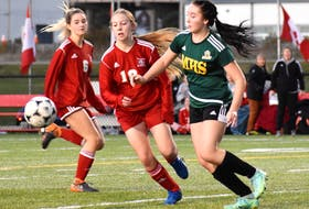 Abby Bradley of the Memorial Marauders, right, and Clare Connors of the Riverview Ravens, battle for the ball during Game 1 of the School Sport Nova Scotia Highland Region Division 1 girls' soccer championship at Open Hearth Park in Sydney, Thursday. The game finished in a scoreless draw. JEREMY FRASER/CAPE BRETON POST.