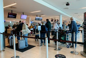 Travellers line up to check in for flights at  Halifax Stanfield International Airport the Friday before Thanksgiving. Stuart Peddle - The Chronicle Herald