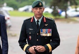 Maj.-Gen. Dany Fortin arrives to be processed at the Gatineau Police Station in Gatineau, Que., on Wednesday, Aug. 18, 2021. THE CANADIAN PRESS/Justin Tang