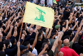 Supporters of Lebanon's Hezbollah attend a funeral of people who were killed in recent violence in Beirut in Beirut's southern suburbs Oct. 15.