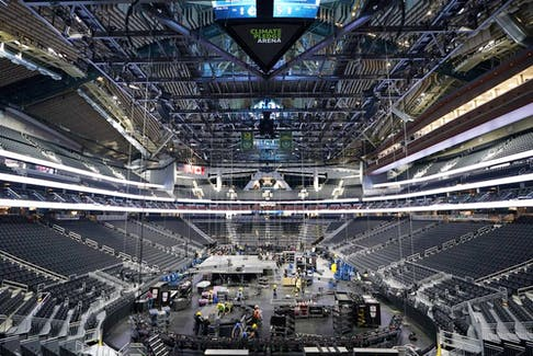 The floor and seating areas of Climate Pledge Arena are shown Wednesday, Oct. 20, 2021, during a media tour ahead of the NHL hockey Seattle Kraken's home opener Saturday against the Vancouver Canucks in Seattle. The historic angled roof of the former KeyArena was preserved, but everything else inside the arena, which will also host concerts and be the home of the WNBA Seattle Storm basketball team, is brand new.