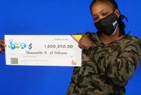 Shawnette Rowe, 50, holding her $1 million lottery win