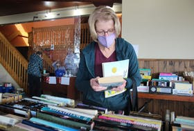 Yvette MacLellan was one of the people to stop by the Rotary Book Drive on Friday, Oct. 21. MacLellan said that she enjoys Nicholas Sparks books, but didn't come to the sale to find more, as she had already read them all.