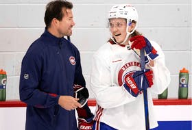 Canadiens defenceman Sami Niku chats with assistant coach Luke Richardson during training camp at the Bell Sports Complex in Brossard.