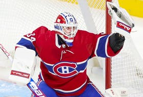 Montreal Canadiens' Jake Allen makes a glove save during third period against the Carolina Hurricanes in Montreal on Oct. 21, 2021.