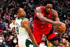 Romeo Langford of the Boston Celtics fouls OG Anunoby of the Toronto Raptors during the Celtics home opener at TD Garden on October 22, 2021 in Boston, Massachusetts.
