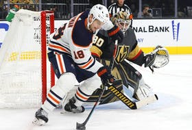 Robin Lehner #90 of the Vegas Golden Knights defends the net against Zach Hyman #18 of the Edmonton Oilers in the first period of their game at T-Mobile Arena on October 22, 2021 in Las Vegas, Nevada.