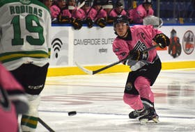 Sean Larochelle of the Cape Breton Eagles, right, fires a point shot on goal as Justin Robidas of the Val-d'Or Foreurs attempts to block it during Quebec Major Junior Hockey League action at Centre 200 on Friday. Cape Breton won the game 2-0. JEREMY FRASER/CAPE BRETON POST.