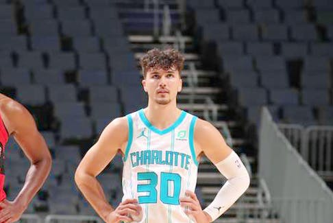 Bedford's Nate Darling during a game for the NBA's Charlotte Hornets last season.