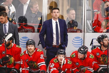 Chicago Blackhawks head coach Jeremy Colliton looks on from the bench during the first period of a NHL game against the Vancouver Canucks at United Center on Oct. 21.