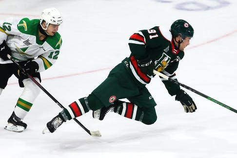 Halifax Mooseheads Elliott Desnoyers, gets tripped by Val-d'Or Foreurs Jason Desruisseaux during 1st period QMJHL action in Halifax Saturday October 23, 2021. Desruisseaux was given a penalty on the play.  TIM KROCHAK PHOTO