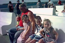 Ed Phalen with his children aboard a ferry.