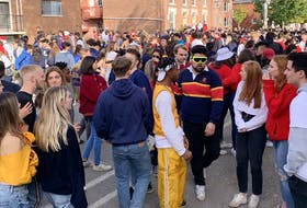 Students gather on William Street in Kingston's University district on Saturday.