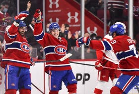 Canadiens' Mathieu Perreault, left, celebrates his third goal of the game with teammates Cole Caufield, centre, and Tyler Toffoli during the third period against the Detroit Red Wings at the Bell Centre on Saturday, Oct. 23, 2021, in Montreal.