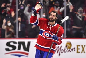 The Canadiens' Mathieu Perreault, who was born and raised in Drummondville, waves to fans at Bell Centre after scoring three goals and being named the first star of 6-1 win over the Detroit Red Wings Saturday night.