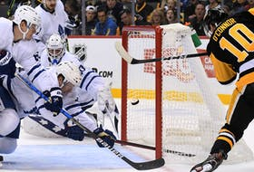 Penguins left wing Drew O'Connor misses a wide-open  Maple Leafs during the third period at PPG Paints Arena. The Penguins won 7-1.
